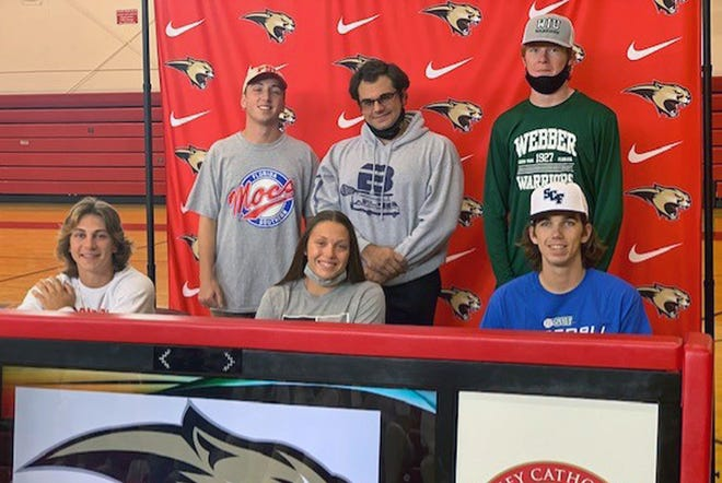 Cardinal Mooney signing day: front row from left, Todd Velotta; Sylvia Liszewski; Aiden Troy, back row from left, Chris Donnelly; Anthony Fayette; and Emerson Windom