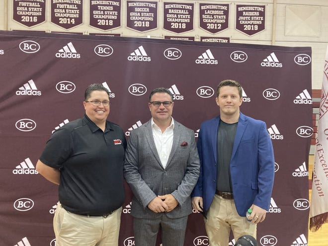 Kevin Thomas of ESPN Savannah, left, with Benedictine football coach Danny Britt, center, and Christian Goeckel of ESPN Savannah.
