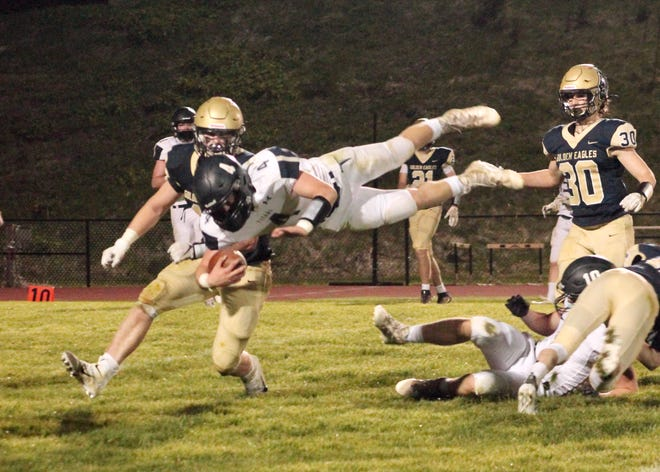 Annawan-Wethersfield quarterback Coltin Quagliano (4) leaps for a 7-yard gain on the final series of the game. He was hit while airborne and had to leave the game for one play.
