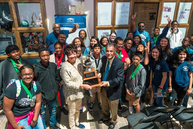 """The Brunswick County ROCAME team is pictured April 21, 2018, with UNCW Chancellor Jose V. """"Zito"""" Sartarelli. The Brunswick schools were the overall winners of the 2018 ROCAME Regional Jamboree."""