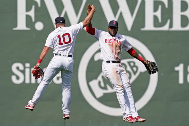 Boston Red Sox outfielders Hunter Renfroe (10) and Franchy Cordero, right, celebrate their 11-4 victory over the Chicago White Sox at Fenway Park Monday in Boston.