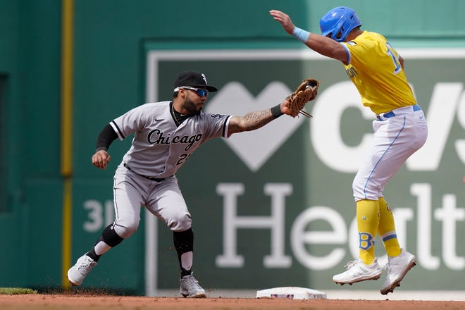 Chicago's Leury Garcia, left, reaches to Boston's Hunter Renfroe, right, as Renfroe is picked off and caught steeling second in the fourth inning of Sunday's doubleheader opener.