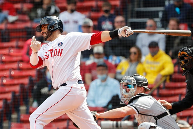 Boston's J.D. Martinez follows through on an RBI single against the White Sox during the seventh inning Monday at Fenway Park.