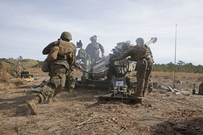 Marines with Alpha Battery, 1st Battalion, 10th Marine Regiment, 2nd Marine Division, fire a 155mm Howitzer during the regiment's Rolling Thunder exercise March 12, 2019, at Fort Bragg. The Marines are back in the area for the biannual training exercise through the end of April 2021.