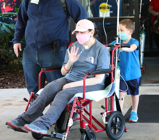 Kristin Kay, a Gainesville nurse, mother and University of Florida graduate who has been battling severe COVID-19 complications since just after Christmas, leaves North Florida Regional Medical Center on Monday with the help of her son, Parker, and husband, Steven. Kristin Kay was at NFRMC for 111 days and on a ventilator for around 100 of them.