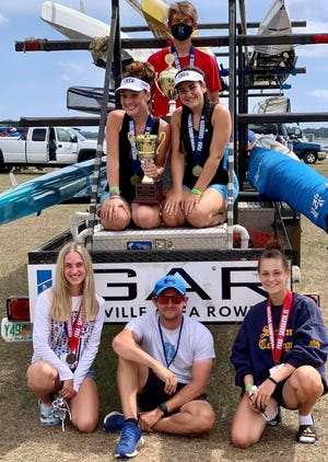 The Gainesville Area Rowing team members who medaled at a recent event in Sarasota.