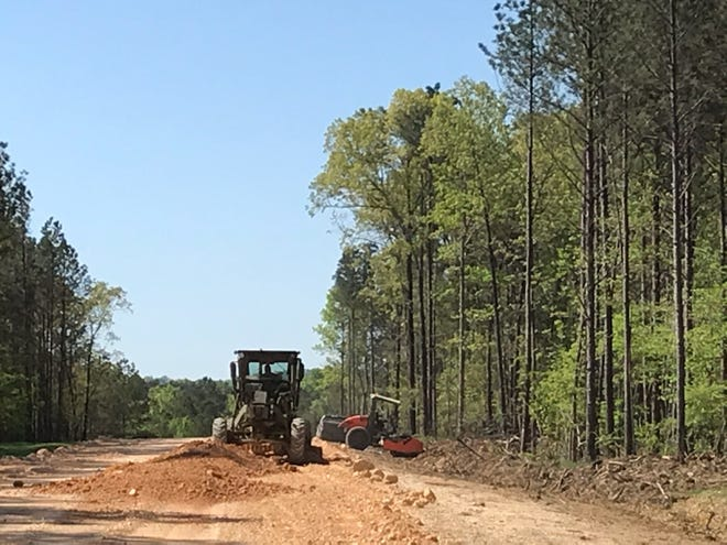 Rainbow City's public works department continues final grading work on the new road leading to the Etowah County Mega Sports Complex, connecting Lindsey Street and Kinzie Lane.