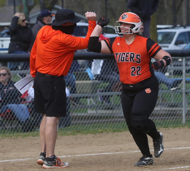 Strasburg's Bri Christner celebrates as she makes her way to the plate after hitting a home run in the game with Tusky Valley Monday. The Tigers won the game 9-3.
