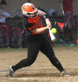 Strasburg's Emma Gilkerson hits a home run in the game Monday with Tusky Valley.