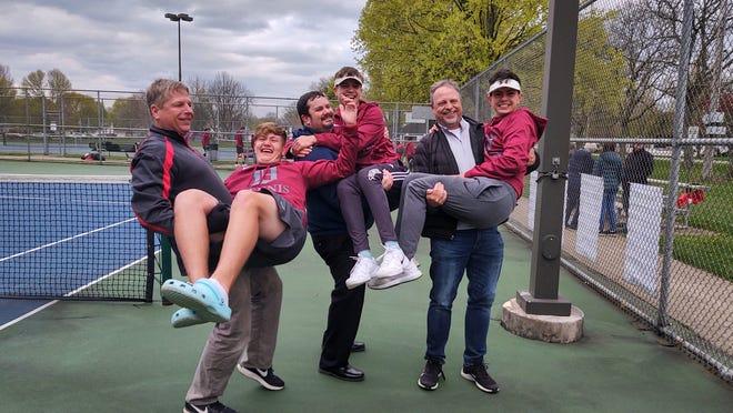 Mac and Ethan Aljancic, Matt and Carter Zeedyk, Brian and Brecken Bigler celebrate after a recent Dover High School boys tennis match.
