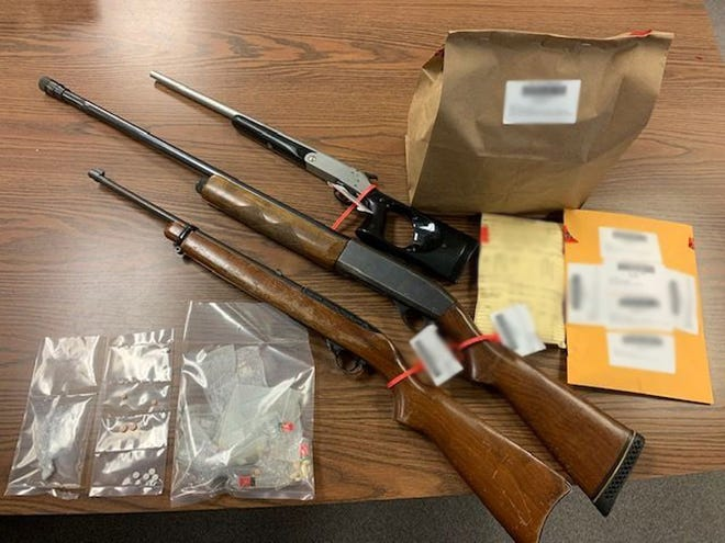 Several weapons, drugs and other items were seized.