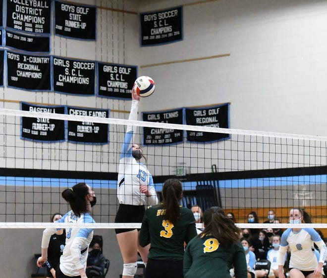 Pueblo West's Gracie Bossow reaches for a kill in Tuesday night's match against Pueblo County.