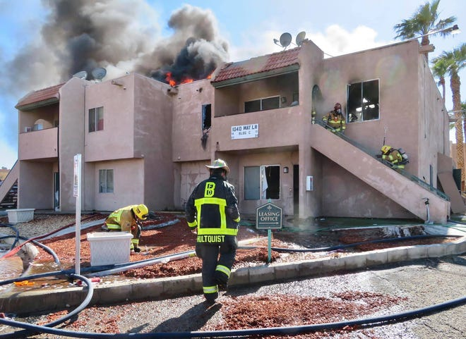 Barstow Fire Protection District firefighters battle a fire that broke out at the May Lane Apartments in Barstow on Sunday, April 18, 2021.