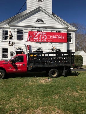 Second Parish in Hingham kicks off its 275th anniversary celebration with a huge banner across the front of the church. This year's celebration is planned to create awareness of the history of the church and service to the community of Hingham.