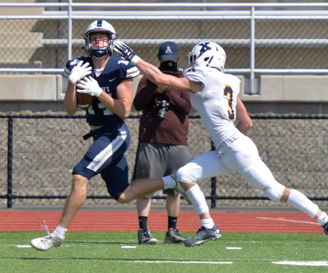 Boxford's Jackson Delaney, his mask momentarily dislodged by contact with a defender, has been a critically important deep threat as a junior wideout in this spring's Fall II campaign for St. John's Prep (3-3), which is averaging 27 points per game.