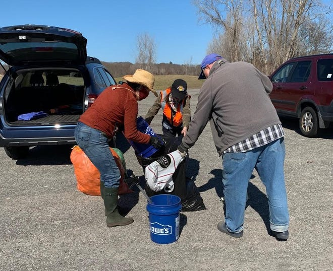 Members of Scituate Trashed are shown getting things done on the Driftway.