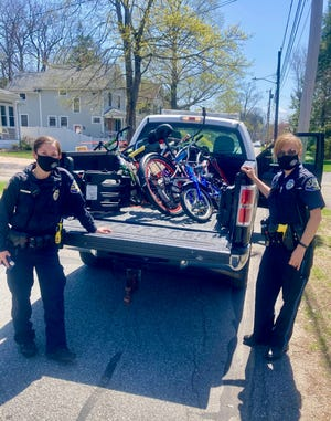 Storytime Crafts Inc., a charitable nonprofit in Needham, has collected and distributed 280 bikes to children and communities in need since the beginning of the pandemic. Pictured are Officer Nicole McMahon, School Resource Officer and Officer Katie McCullough, NPD, picking up bikes to deliver to kids.