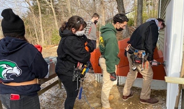 Essex Tech High School students participate in projects with Habitat for Humanity.