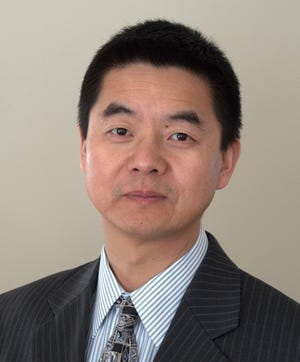 School Committee incumbent and candidate Mingquan Zheng