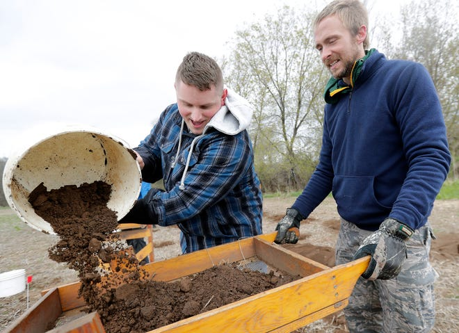 University of Wisconsin-Oshkosh anthropology student John Bargo and associate professor Jordan Karsten, right, sift through soil earlier this spring in the search for the body of Starkie Swenson on property in the town of Rushford. Swenson disappeared on the night of Aug. 13, 1983, and is believed to have been murdered.