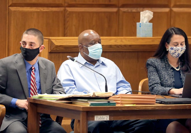 Johnny Scott, center, attends an April hearing with his attorneys, Timothy Hogan and Amanda Belville. Scott was convicted of a homicide charge for the death of Annie Ford, 48, and sentenced Tuesday to life in prison without the possibility of release.