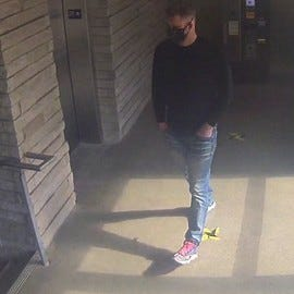 Cincinnati police are asking the public for help in identifying a man accused of punching a man in the back of the head and robbing him in Pendleton.