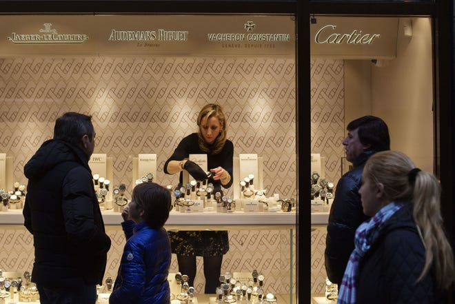 A worker arranges watches at the Wempe Jewelers store on Fifth Avenue in New York on March 24, 2016.