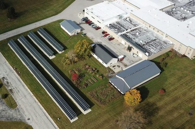 An aerial view of the 408-panel solar farm built on the grounds of the Algoma School District last summer. The district said the school so far is saving $600 to $800 a month on its energy bills since the farm was activated at the end of September.