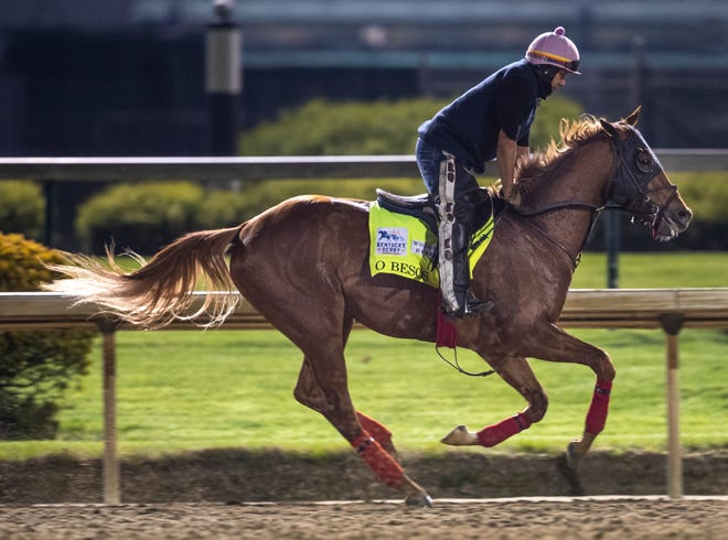 Kentucky Derby hopeful O Bezos gallops over the track at Churchill Downs. April 19, 2021