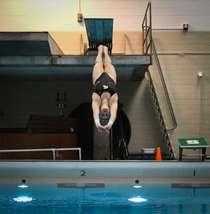 MSU senior diver Amanda Ling practices for the first round of the NCAA diving zone meet Wednesday morning, March 3, 2021, at the IM Sports West indoor pool, home to the men's and women's MSU swimming and diving teams.  This will be the final season for the program, which has competed since 1922.