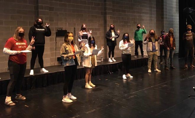 Cedarburg High School choir students stay socially distanced during rehearsal.