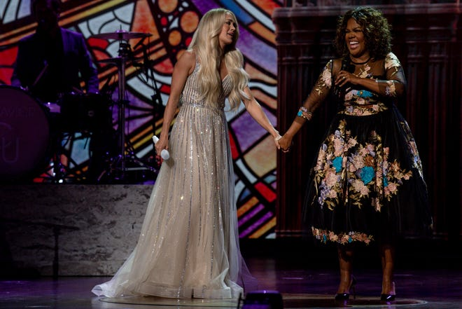 Carrie Underwood and CeCe Winans perform together at the Grand Ole Opry House during the filming of their performance for the 56th Academy of Country Music Awards on Saturday, April 17, 2021 in Nashville, Tenn.