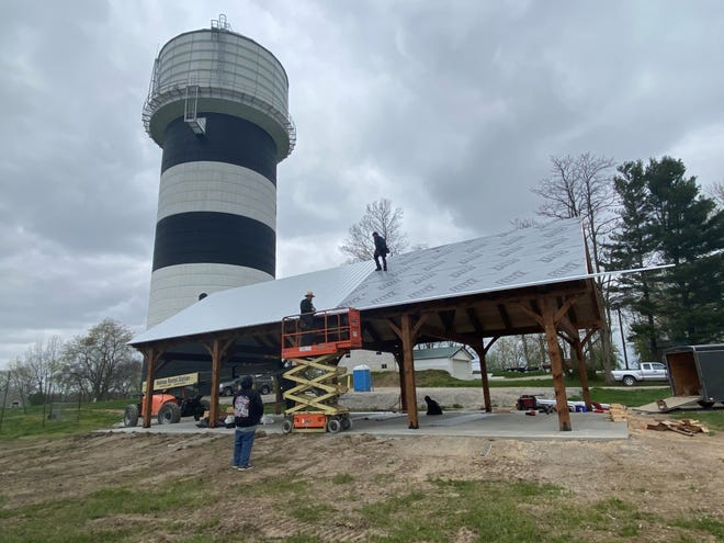 Employees for the Fredericksburg-based Woodland Timberframing install the roof on a pavilion in Buckeye Lake on Friday, April 16, 2021.