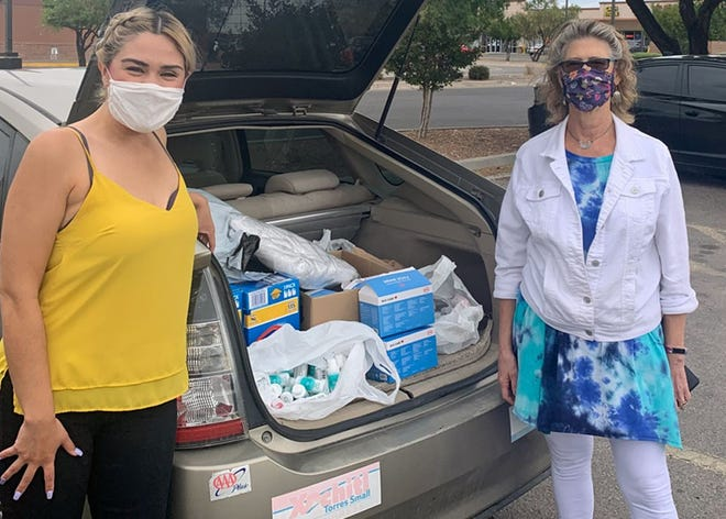 Barbara Gabioud (right) gathers supplies for people in need across the border.