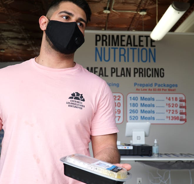 Primealete Nutrition owner Abbas Zreik displays one of his meal planning business' dinners at their Novi location.