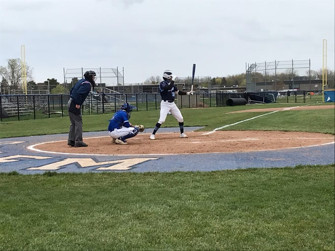 Livonia Stevenson senior Aidan Arbogast prepares his stance prior to launching his first home run of the game against Salem.