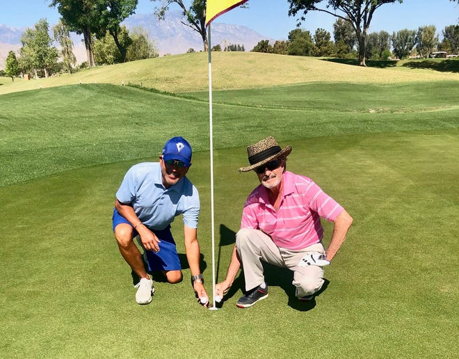 John Kobara (left) and Richard Kievman each scored a hole in one on the par-3 12th hole of the Players Course at Indian Wells Golf Resort on April 19 while playing in the same foursome