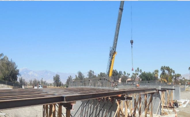 Construction crews work on a new bridge along Cathedral Canyon Drive in Cathedral City.