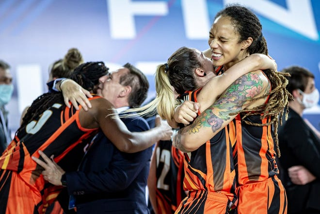 Brittney Griner, right, celebrates winning her fourth EuroLeague women's basketball title Sunday with her Russian team UMMC Ekaterinburg. Griner next will play for the WNBA Phoenix Mercury in summer 2021.