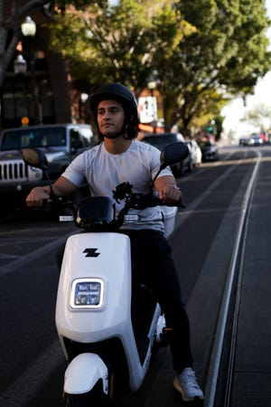 Zebra owner R.J. Napolitano takes his e-bike for a spin on Mill Avenue in Tempe. Napolitano co-founded the Phoenix electric bike company in 2019 to give people an alternative affordable form of transportation while reducing their carbon footprint.