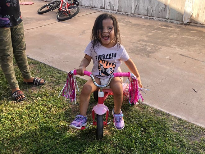 Nila, who's 3, was pretty excited to get her own bike.