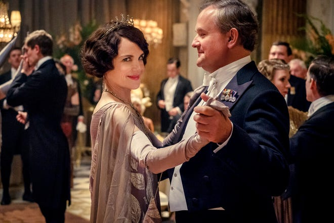 """This image released by Focus Features shows Elizabeth McGovern, left, as Lady Grantham and Hugh Bonneville, as Lord Grantham, in """"Downton Abbey"""". The original principal cast of """"Downton Abbey"""" are returning for a second film that will arrive in theaters December 22 this year, Focus Features announced Monday. """"Downton Abbey"""" creator Julian Fellowes has written the screenplay, and Simon Curtis is directing. (Jaap Buitendijk/Focus Features via AP)"""