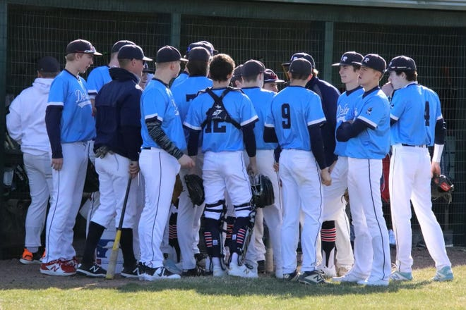 The Dell Rapids baseball team during a timeout against Tri-Valley on April 1, 2021.