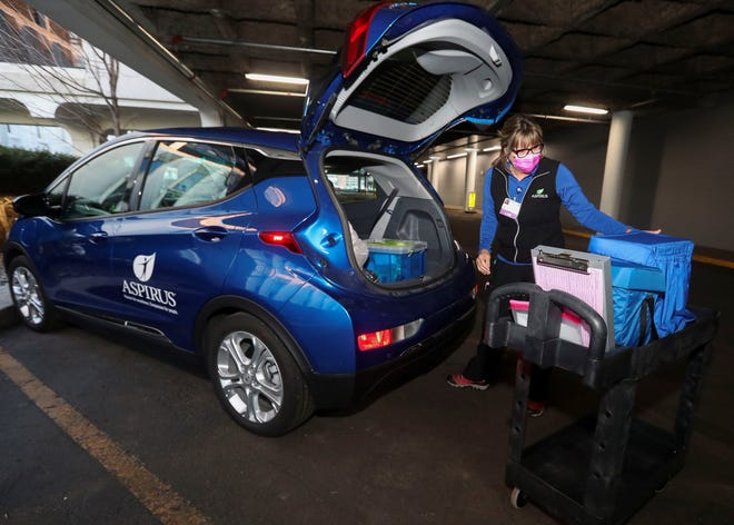 Linda Prehn prepares to take Aspirus' Chevrolet Bolt EV out on her courier route.