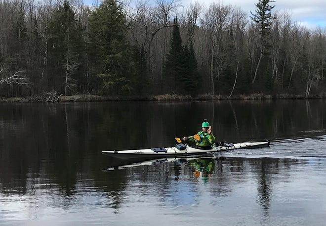 Jason Pientka flashes a V for victory sign on the Wisconsin River between Merrill and Tomahawk on April 15. He was going with the current and had the wind to his back.
