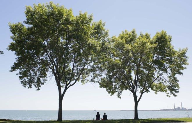 A couple take in Lake Michigan along Broughton Drive last August in Sheboygan.