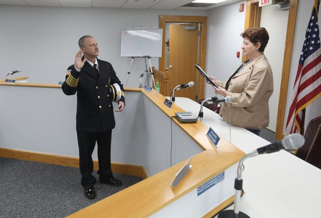 South Zanesville Mayor Barb Lloyd swears in Russell Taylor as Chief of the South Zanesville Fire Department. With the swearing in Taylor becomes the first full-time employee for the department. He is also the second full-time chief in the county outside of Zanesville.