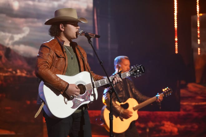 """Rocking a cowboy hat, Caleb Kennedy, 16, performedWillie Nelson's """"On the Road Again"""" from the film """"Honeysuckle Rose,"""" accompanying himself on the guitar."""