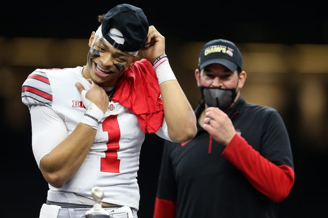 Ohio State Buckeyes quarterback Justin Fields (1) celebrates with head coach Ryan Day after defeating the Clemson Tigers at Mercedes-Benz Superdome.