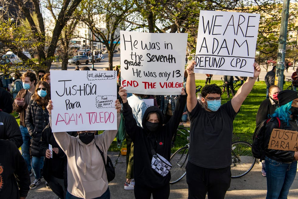 Activists are pictured protesting near Mayor Lori Lightfoot's home in Chicago, a day after the release of body camera footage that showed a Chicago police officer fatally shooting Adam Toledo, 13, in late March.